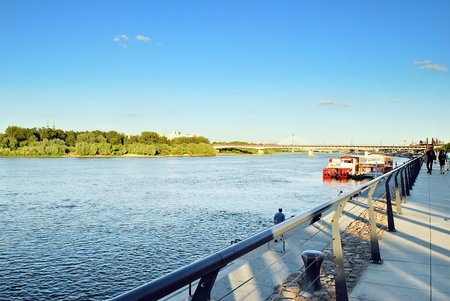 first day: Warsaw, Poland. June 15, 2017. Vistulan Boulevards on the western side of the River Vistula in Warsaw. The promenade at the bank of the Vistula river Editorial