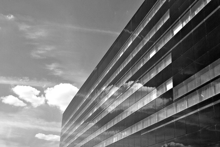 headquarters: Modern office building. Architectural details of modern building. Black and white.