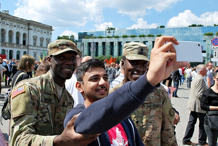 Warsaw, Poland. 6 July 2017.Group of american soldiers taking selfie with cywilians. Krasinski Square.