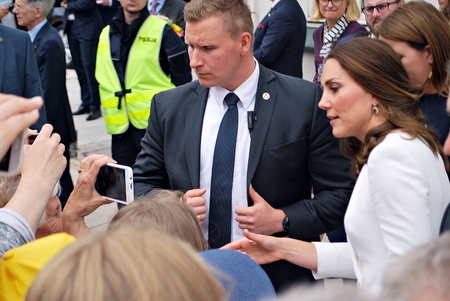 Warsaw, Poland.17 July 2017.Kate Middleton greeting crowds in Warsaw. People cheering for Kate and William. People are taking photos. Blurred background.