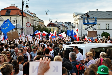 Warsaw, Poland. 24 July 2017. Protesters rally in front of the presidential palace in Warsaw. Protesters hold posters reading constitution during a demonstration in front of the presidential palace.