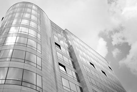 Modern building.Modern office building with facade of glass. Black and white.