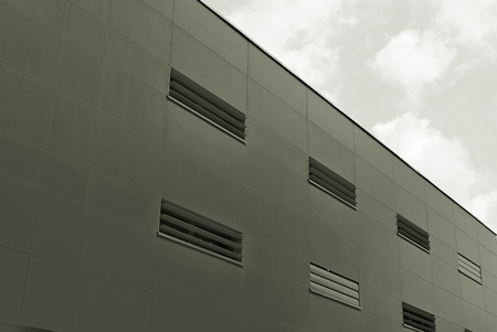 mirror frame: Modern building.Modern office building with facade of glass. Black and white.
