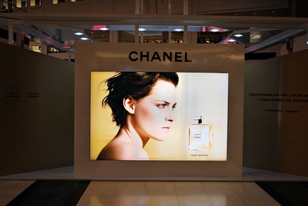 specializes: Warsaw, Poland. 7 September 2017. Chanel on billboard at Arkadia shopping center. Chanel is a high fashion house, specializes in clothes, luxury goods and fashion accessories. Editorial