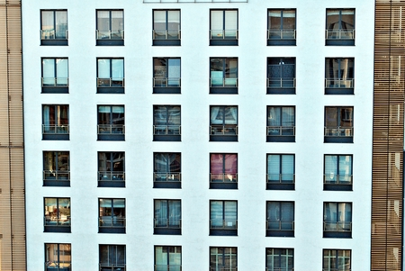 Modern, Luxury Apartment Building against blue sky Banco de Imagens