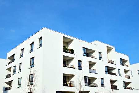 Modern apartment buildings on a sunny day with a blue sky