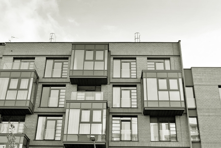 Modern Apartment Building. Facade Of A Modern Apartment Building. Black And  White. Photo