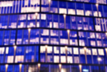 Night lighted bokeh city office building, abstract background