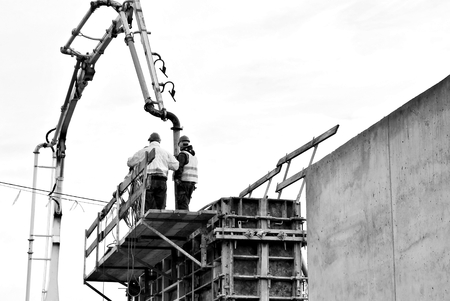 Construction workers on a scaffold.