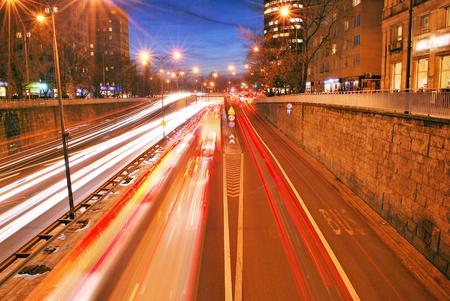 Evening traffic. The city lights. Motion blur.Night traffic jam, Traffic jam in city center