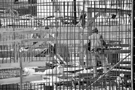 Construction site workers. Black and white.