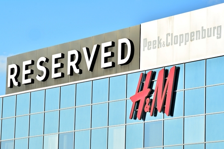 Warsaw, Poland. 24 February 2018.Sign H & M, Reserved. Company signboard H & M, Reserved.