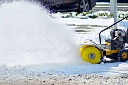 Removing the snow by snow blower Stock Photo