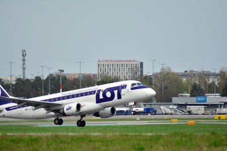 Warsaw, Poland. 15 April 2018. Passenger airplane Embraer 175 PLL LOT Airlines is flying from the Warsaw Chopin Airport runway