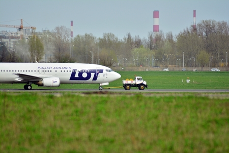 Warsaw, Poland. 15 April 2018. Warsaw Chopin Airport. Turning left to apron after landing.Plane line LOT Polish Airlines at the airport in Warsaw Redakční
