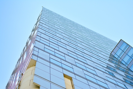 Urban abstract background, detail of modern glass facade, office business building
