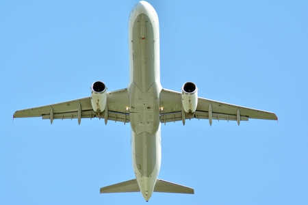 Passenger plane is flying up from runway of airport
