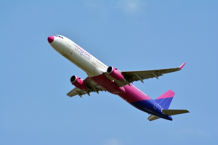Warsaw, Poland. 15 April 2018. Passenger airplane Airbus A321-231 WIZZ Air Airlines is flying from the Warsaw Chopin Airport runway