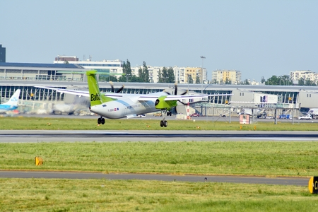 Warsaw, Poland. 1 June 2018. Passenger airplane YL-BBW - Bombardier Dash 8 Q400 - Air Baltic just before landing at the Chopin airport. Editorial