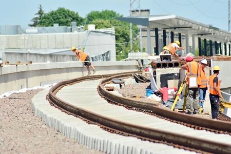 Railway Workers repairing railway on hot summer day