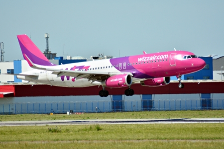 Warsaw, Poland. 8 June 2018. Plane HA-LYD - Airbus A320-232 - Wizz Air just before landing at the Chopin airport. Editorial