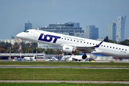 Warsaw, Poland. 24 July 2018. Airplane SP-LNK LOT - Polish Airlines Embraer ERJ-195LR taking off from the Warsaw Chopin Airport.