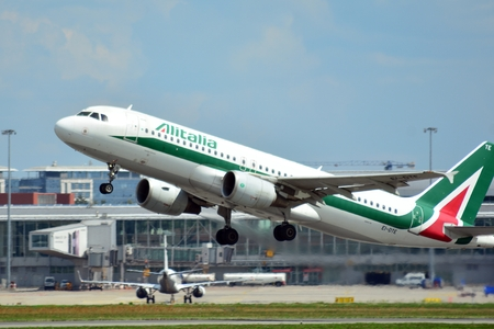 Warsaw, Poland. 26 July 2018. Airplane EI-DTE Alitalia Airbus A320-216 taking off from the Warsaw Chopin Airport.