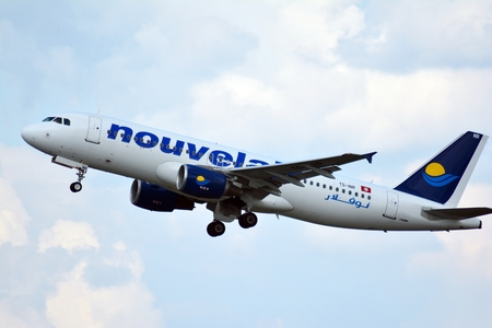 Warsaw, Poland. 26 July 2018. Airplane TS-INR Nouvelair Tunisie Airbus A320-214 taking off from the Warsaw Chopin Airport.
