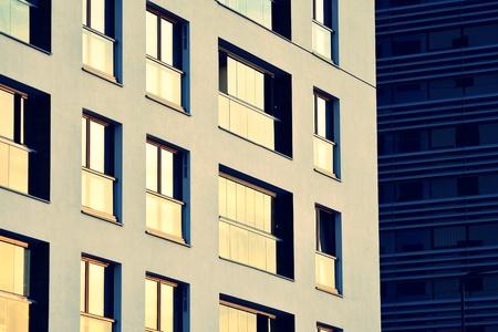 Modern apartment building exterior. Retro colors stylization 版權商用圖片