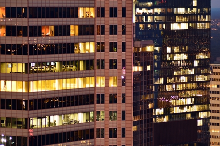 Modern office building at night. Night lights, city office building downtown, cityscape view Stock fotó