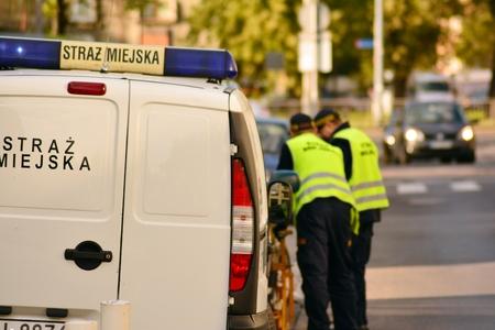 Warsaw, Poland. 1 October 2018. Municipal Police. Car wheel blocked by wheel lock. Illegal parking violation