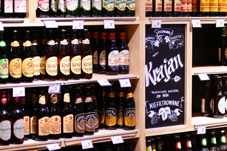 Szczecin, Poland. 6 October 2018. Shelf with beer bottles in a Carrefour supermarket