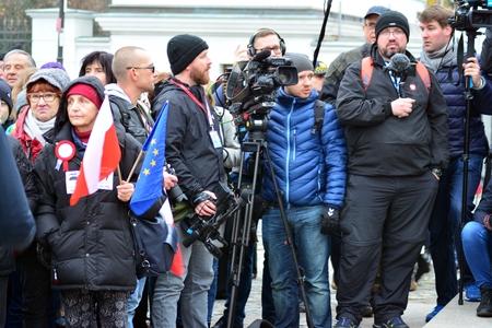 Warsaw, Poland November 11, 2018. Many photographers holding camera.