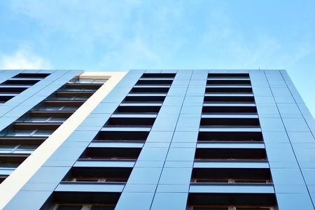 New apartment block with blue sky in the background Stok Fotoğraf