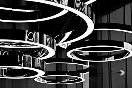 Abstract interior fragment. Stylized illumination with modern LED lamps. Black and white.