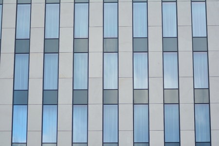 Modern building with reflected sky and cloud in glass window