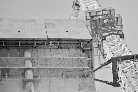 Crane attached to building. Black and white. 免版税图像