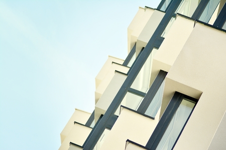 Modern white building with balcony on a blue sky Stock Photo