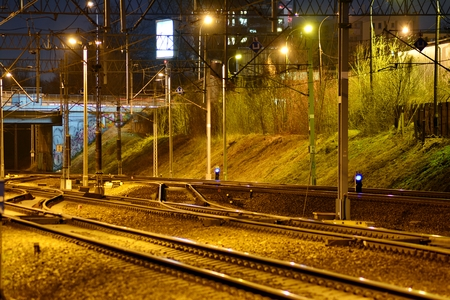 Confusing railway tracks at night Imagens