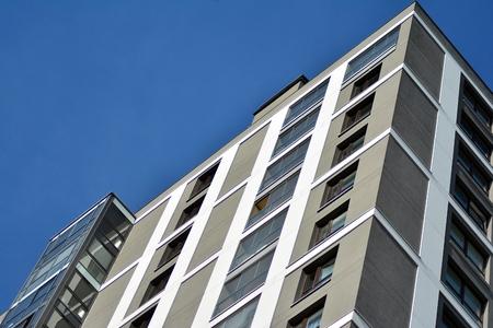Multistory new modern apartment building. Stylish living block of flats.