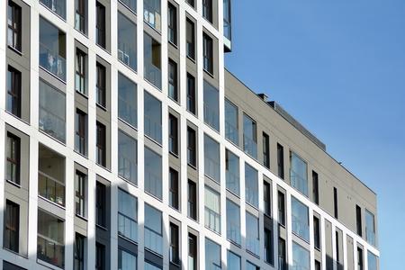 Multistory new modern apartment building. Stylish living block of flats. Stock Photo