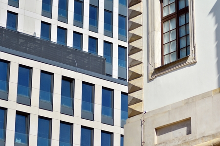 Fragment of abstract architecture - modern urban beauty geometry. Blue glass wall.
