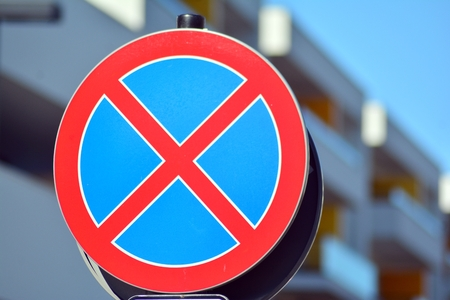 The urban clearway sign with blue skies in the background. Stok Fotoğraf