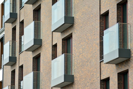 European modern residential architecture. Fragment of a modern apartment building in front. Very modern apartment house. Banco de Imagens
