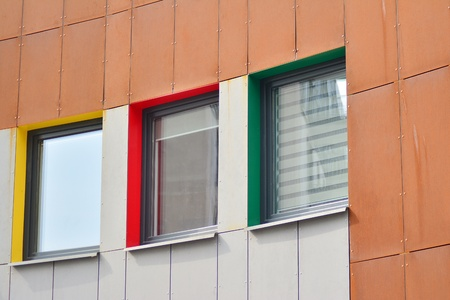 European modern residential architecture. Fragment of a modern apartment building in front. Very modern apartment house. Imagens