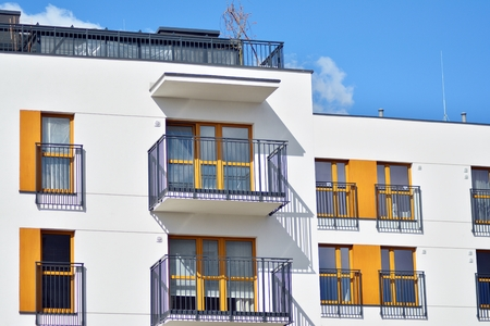 European modern residential architecture. Fragment of a modern apartment building in front. Very modern apartment house.