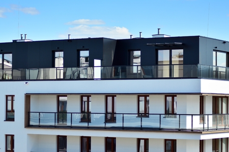 European modern residential architecture. Fragment of a modern apartment building in front. Very modern apartment house