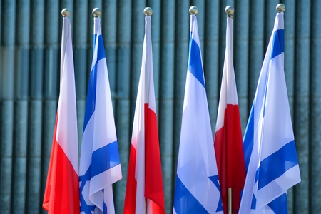 Poland and Israel flag waving in the wind. Israel and Poland two flags textile cloth.