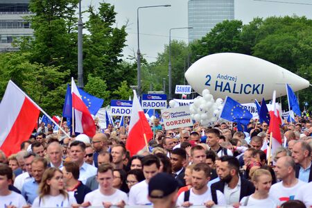 Warsaw, Poland. 18 May 2019.Thousands of opposition supporters marched in the Polish capital to celebrate the nation's European Union membership ahead of the European Parliament election. Stok Fotoğraf - 128622631