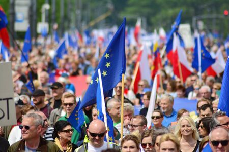 Warsaw, Poland. 18 May 2019.Thousands of opposition supporters marched in the Polish capital to celebrate the nation's European Union membership ahead of the European Parliament election. Stok Fotoğraf - 128622683